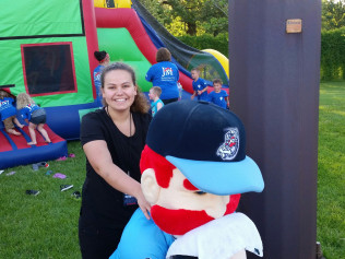 Alyse giving the St. Cloud Rox mascot a well deserved break!
